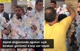 Aşiret düğününde damada takılan parayı 4 kişi zor taşıdı